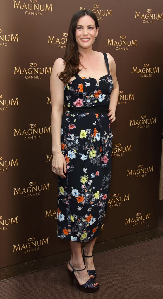 Liv Tyler delivered fresh florals to the Magnum photocall in Cannes in her bustier-style midi-length Tanya Taylor dress.