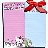 Write down each gift you need to get on the Christmas Holiday Hello Kitty Notepad Bundle ($10).