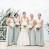 These bridesmaids wore icy gray gowns in different styles.
