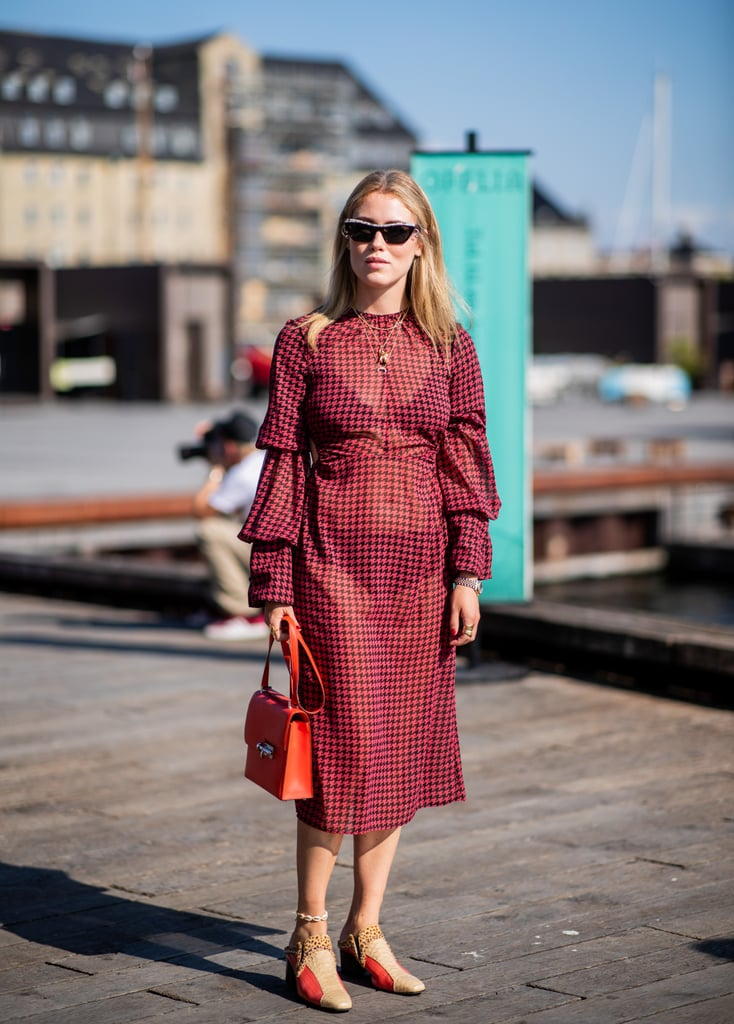 Styling a plaid dress with black undergarments and mules.