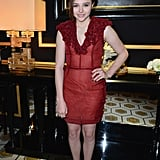 Chloë Moretz wore red to the H&M fashion show on Wednesday in Paris.