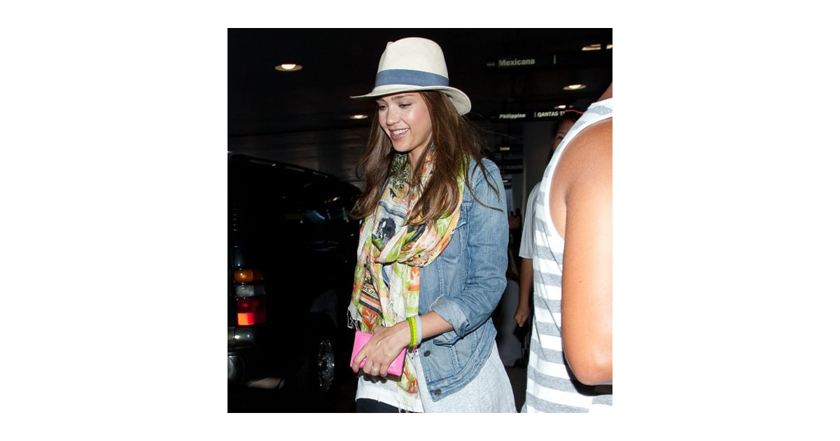 8/17/167/23/12POPSUGARFashionJessica AlbaJessica Alba Wearing a Fedora (Pictures)Jessica Alba's Summer Layers: Denim Jacket, Colorful Scarf, and FedoraJuly 23, 2012 by Mandi Villa2 SharesWhile arriving at LAX airport, Jessica Alba showcased yet another stellar travel look working a denim jacket with black satin baggy pants, a colorful printed scarf, and her Tory Burch fedora. The actress has been deemed the queen of layering by her stylist Brad Goreski and that trait comes in handy during globe-trotting. Jessica accessorized her solid separates with silver python Alexandre Birman flats, a few beaded bracelets, and pink card holder. Take a cue from this trendsetter by pairing a denim jacket and black satin trousers with an eye-catching scarf and fedora for a day of errands or switch the pants for a flirty dress when meeting the girls for brunch.Image Source: Bauer-Griffin OnlineAlexander Wang Classic T Shirt with Pocket T by Alexander Wang Classic T Shirt with PocketSold Out•shopbop.com Alexander Wang Shorts - 웹