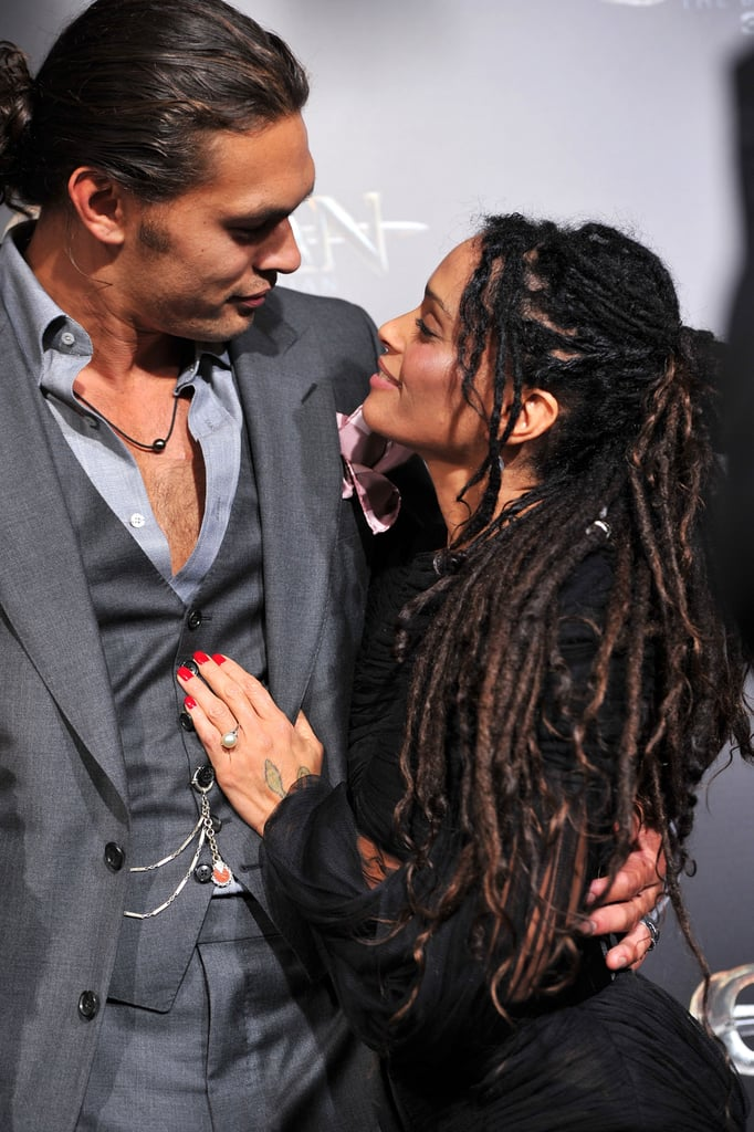 "We can't speak for everyone, but it's hard for us to imagine that ridiculously attractive couple Jason Momoa and Lisa Bonet do anything but stare into each other's eyes all day. The adorably mismatched 6'4"" Game of Thrones actor and the 5'2"" Cosby Show star have been making PDA-filled appearances on the red carpet together ever since they met through mutual friends in 2005. Jason and Lisa later tied the knot in 2007 and have since become the proud parents of two children, Lola and Nakoa-Wolf, and there have been fireworks between them ever since. Keep reading to see their cutest moments as a couple, and then check out the cool, matching tattoos that Jason got with his stepdaughter, Zoë Kravitz!"