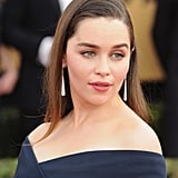 Emilia Clarke's long Cartier drop earrings complemented her sleek red carpet look.