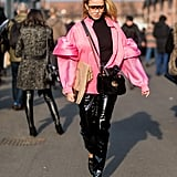 Vinyl looks over the top, yet somehow street style appropriate with a voluminous, millennial pink outfit. So if you're ready to go all out, there should be nothing holding you back.