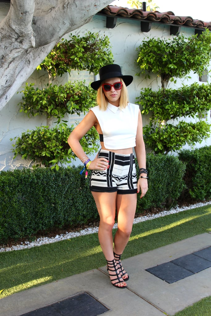 ZZ Ward's festival look got an edgy touch. She paired her high-waisted Topshop shorts with a collared Rehab top and completed her separates with bold red Dolce & Gabbana sunglasses and a YSL hat.