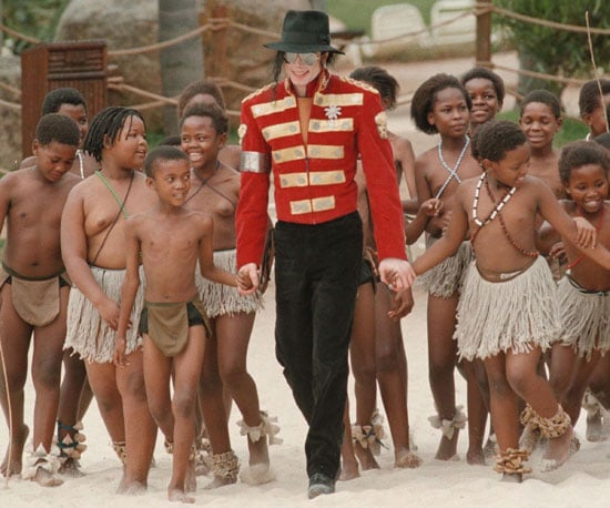 Michael Jackson spent time around the world performing, including with traditional dancers from the Entebbe Primary School in Sun City, South Africa, in 1997.
