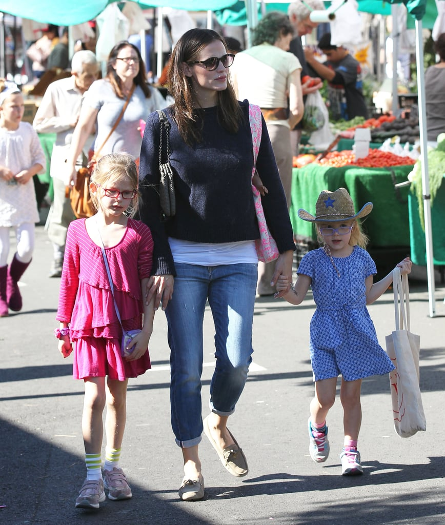Jennifer Garner took her girls, Violet and Seraphina, to the farmers market in LA yesterday. The outing came after an exciting night out for Jen. She joined husband Ben Affleck at the Directors Guild Awards Saturday night as he took home the filmmaker of the year award for his third directorial project, Argo. Jen wore a white Antonio Berardi dress to show her support for Ben during his big night. Jen kicked off her weekend spending quality time with Sera. On Friday, Jen was hand in hand with Seraphina for breakfast and a karate class in LA.