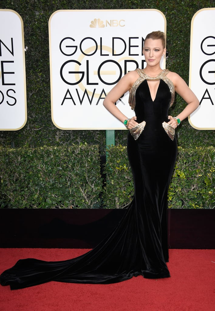 "For the 2017 Golden Globe Awards, Blake Lively didn't just wear any plain old LBD, she wore a black Atelier Versace gown with gold sequinned detailing, teamed with Lorraine Schwartz jewels. She walked down the red carpet with Ryan Reynolds, and we took particular notice of how she always had her hands on her hips.  Perhaps it was her ""comfortable"" pose for the night, but we have a feeling the real reason was to draw attention to the sparkly pocket-like designs on her dress and those megawatt jewels on her wrist. Because she didn't stick her hands inside them, it made us wonder: are those even real pockets? If so, that would be a game changer. Scroll on to see Blake's poses and dress for yourself."