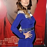 Olivia Wilde put her growing baby bump on display when she attended the Her premiere in LA while wearing a tight David Koma dress.