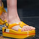 A soft, padded sandal that will still give you a boost.