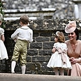 Kate looked on at George and Charlotte, both looking dapper and elegant at Pippa's wedding.