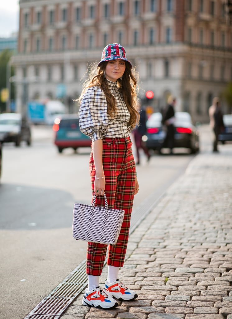 Mix plaid patterns when you pair larger checks with a classic kind of tartan plaid.