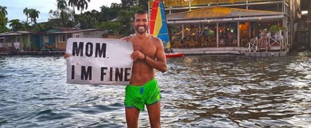 """Guy Travels the World With """"Mom I'm Fine"""" Sign"""