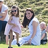 Princess Charlotte had a blast wearing an adorable pink dress, matching sunglasses, and blue plimsolls while watching her dad play polo.