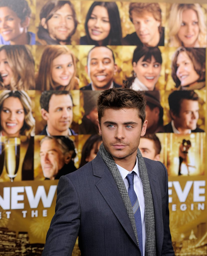 Photographers snapped photos of Zac Efron in front of the movie's poster.