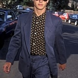 Tom Cruise looked suave in a blue suit and printed shirt on his way into Sean Penn's wedding in August 1985.