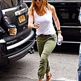 Jennifer ditched the bra and wore a pair of Sanctuary army pants with her Burberry wedges in June 2016.
