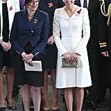 Kate Middleton wore an Alexander McQueen coat and carried a clutch by Anne Grand-Clément during a commemoration event on July 2017.