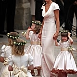 Wearing her famous Alexander McQueen bridesmaid dress at the royal wedding.