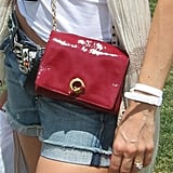 A patent chain-strap mini adds just a little glam-on-the-go to cutoffs.