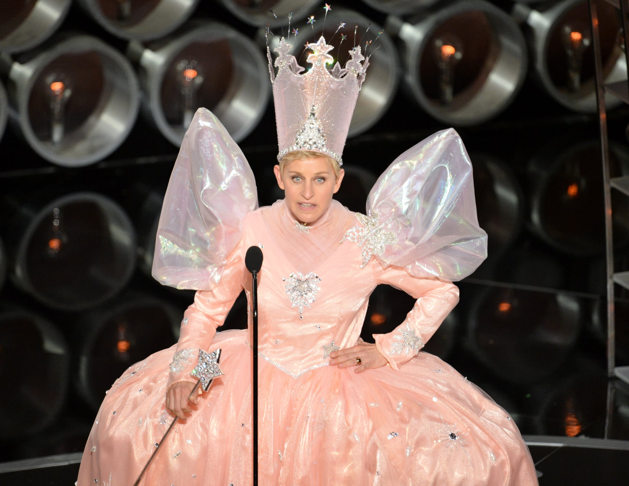 In one of her multiple outfit changes, host Ellen DeGeneres came out dressed as Glinda the Good Witch.