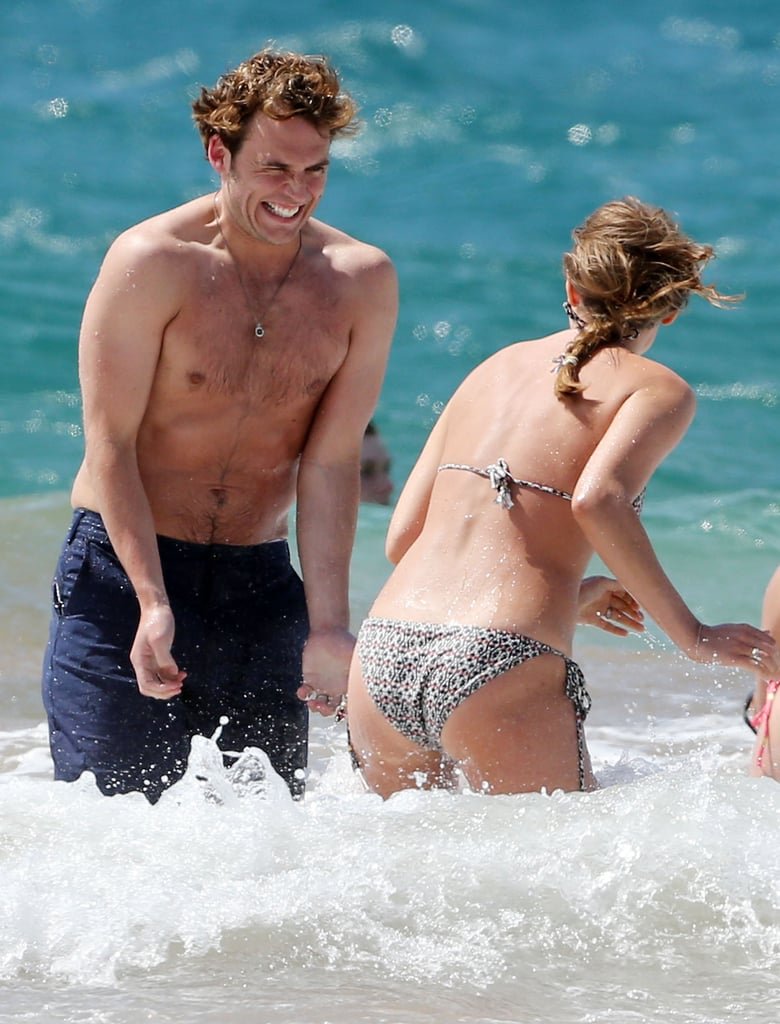 In April 2014, Sam Claflin splashed around with his wife, Lauren Haddock, in Hawaii.