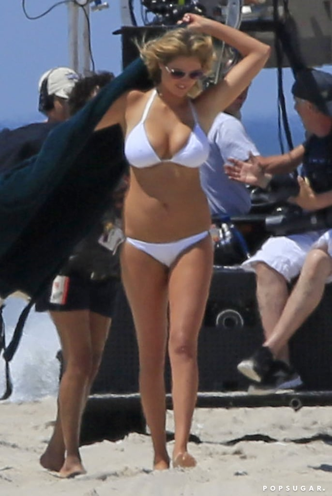 Kate Upton covered up her white bikini with a robe.