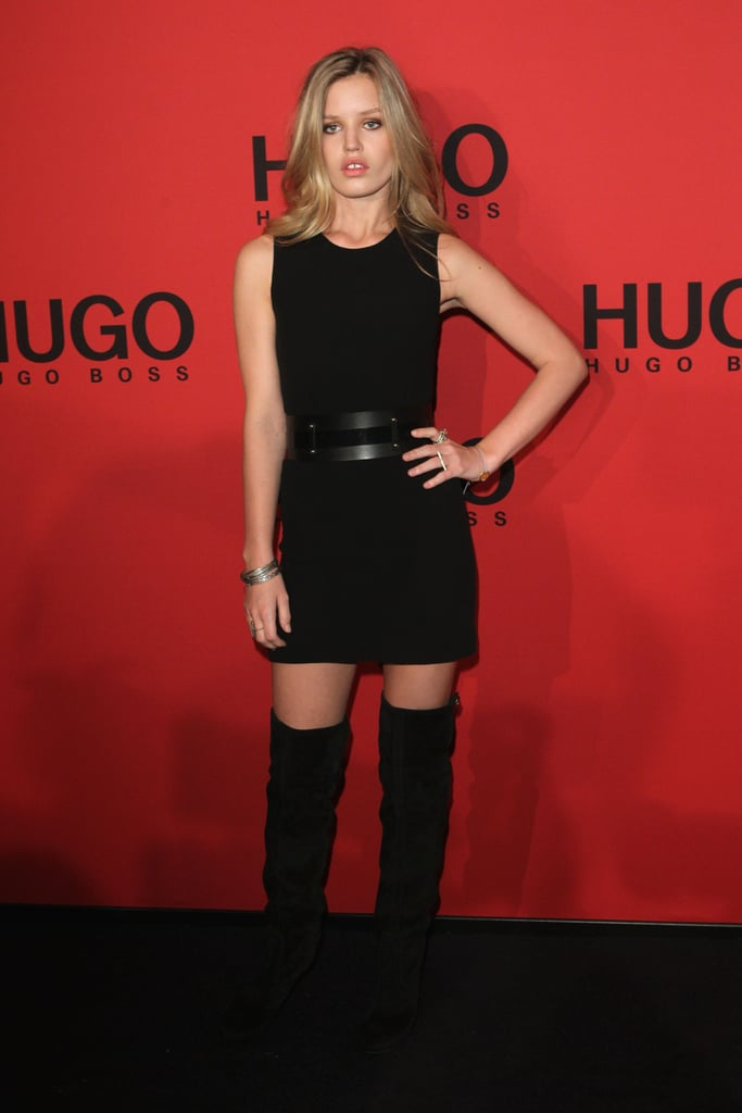 Georgia May knows how to do all black sexy. Just throw on a black sleeveless minidress with black over-the-knee boots and cinch your waist with a wide black cutout belt. Add a few silver bangles and rings to mimic the model's monochromatic look.