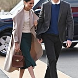 While on a visit to Belfast, Northern Ireland, the duchess wore a gorgeous Mackage coat, a Victoria Beckham jumper, a Greta Constantine skirt, and Jimmy Choo pumps. She accessorized her outfit with a Charlotte Elizabeth Bloomsbury bag and didn't wear any tights.