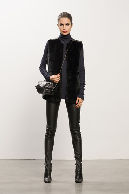 Rabbit Fur Black Vest ($995), Cashmere Navy Turtleneck Sweater ($495), Sweet Revenge Black Leather Legging Boot ($1,995), Sunset Watersnake Black Cross Body Bag ($625) Photo courtesy of Tamara Mellon