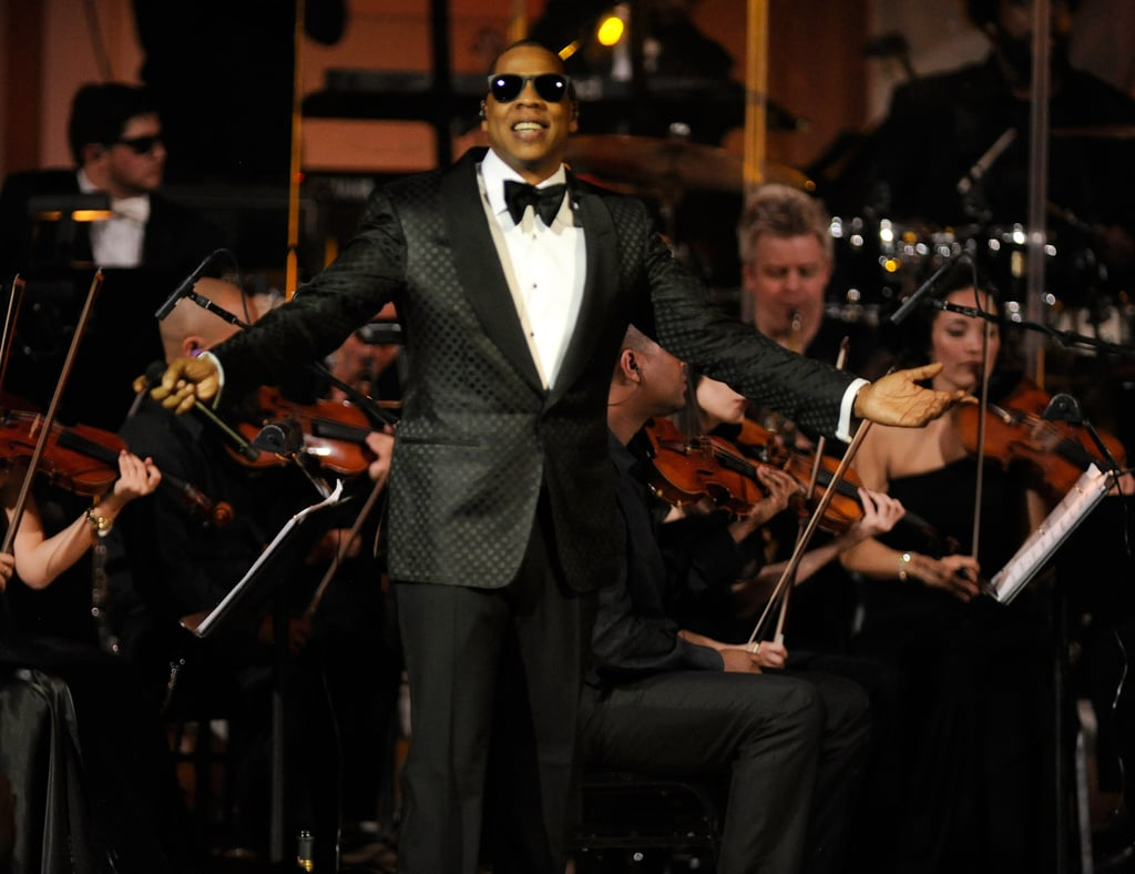 """Jay-Z was beaming as he hit the stage in NYC Monday evening to kick off his two back-to-back Carnegie Hall shows to benefit the United Way as well as his Sean Carter Foundation. It's Jay-Z's first performance since becoming a dad to baby Blue Ivy Carter in early January and he was looking sharp in his Dolce&Gabbana tuxes. New mom Beyoncé Knowles also stepped out for her first appearance since Blue's arrival, and though she stuck to the sidelines during the show Jay-Z did have some special guests including Alicia Keys and Nas. While fans anxiously await the first glimpse of Blue Ivy, the one month old has already broken records. Jay-Z """"Glory,"""" which he wrote and released a day after her birth made Blue the youngest person ever to hit the Billboard charts."""