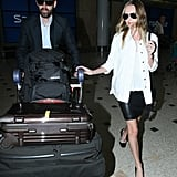 Kate Bosworth and Michael Polish carried their luggage through the airport.