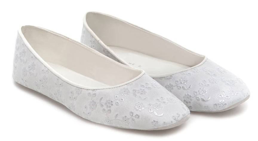 Instead of going the traditional slipper route, we fell in love with these Zara Home ballerina slippers ($50), which give the whole concept of wearing lounge shoes a feminine twist.