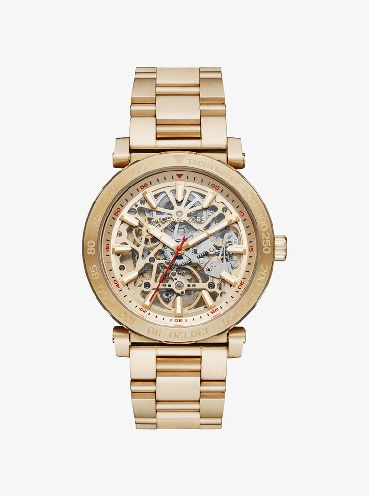 What could be more classic than a gold Michael Kors watch? We love how the Greer style ($425) completely exposes the inside of the dial. Any guy would get a kick out of that.