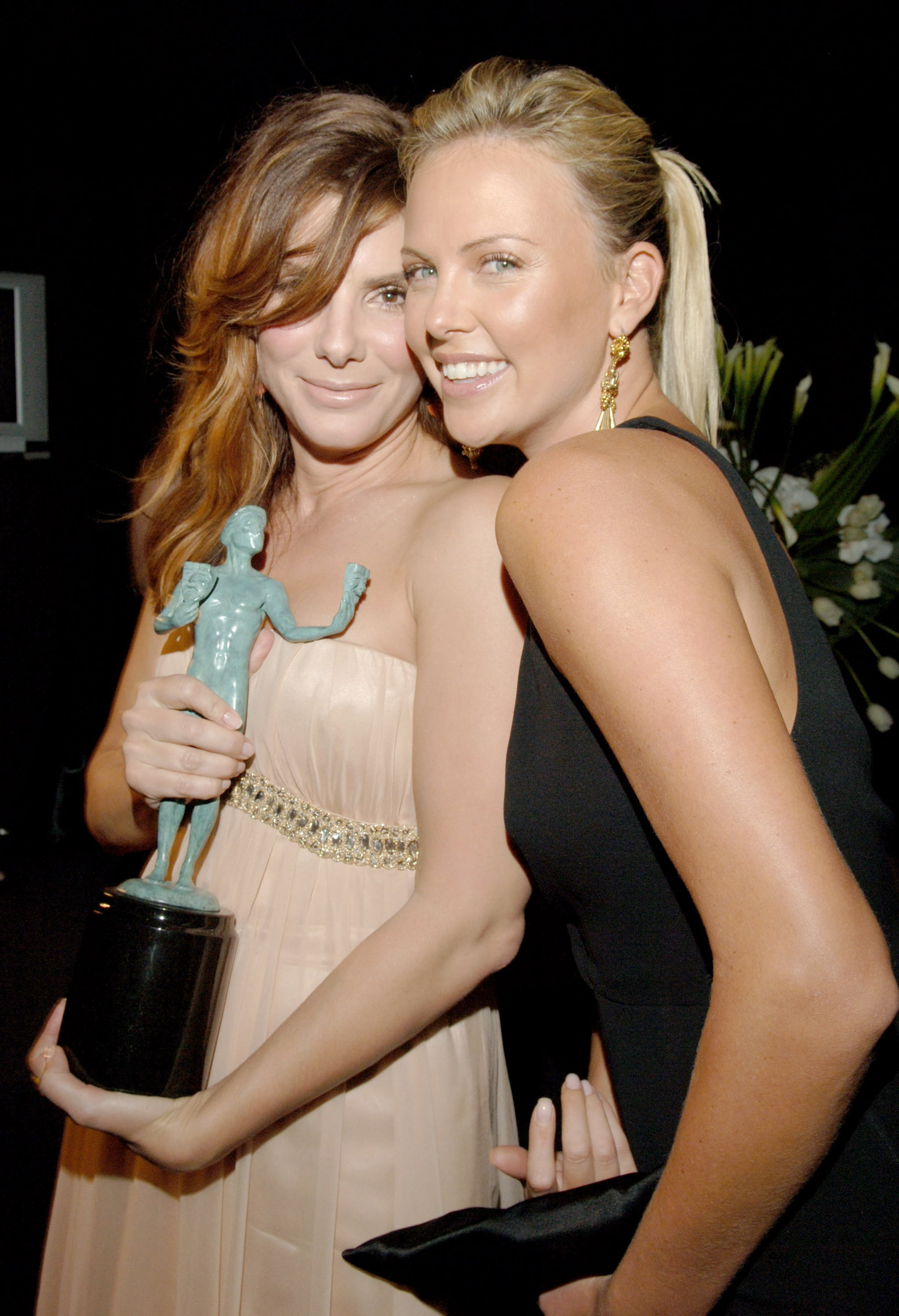 Sandra and Charlize Theron snapped a photo backstage at the January 2006 SAG Awards in LA.