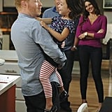Jesse Tyler Ferguson as Mitchell, Ed O'Neill as Jay, Sofia Vergara as Gloria, and Aubrey Anderson-Emmons as Lily on Modern Family.  Photo copyright 2011 ABC, Inc.