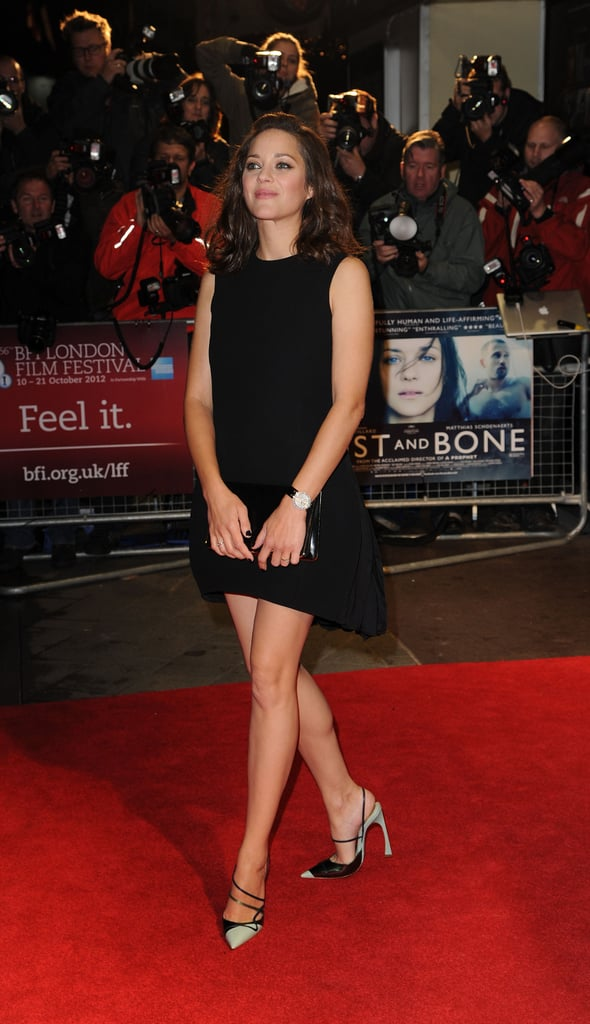 Marion Cotillard made a stunning arrival at the Rust and Bone screening, showing off her stems in a Christian Dior LBD with a slightly asymmetrical hem.