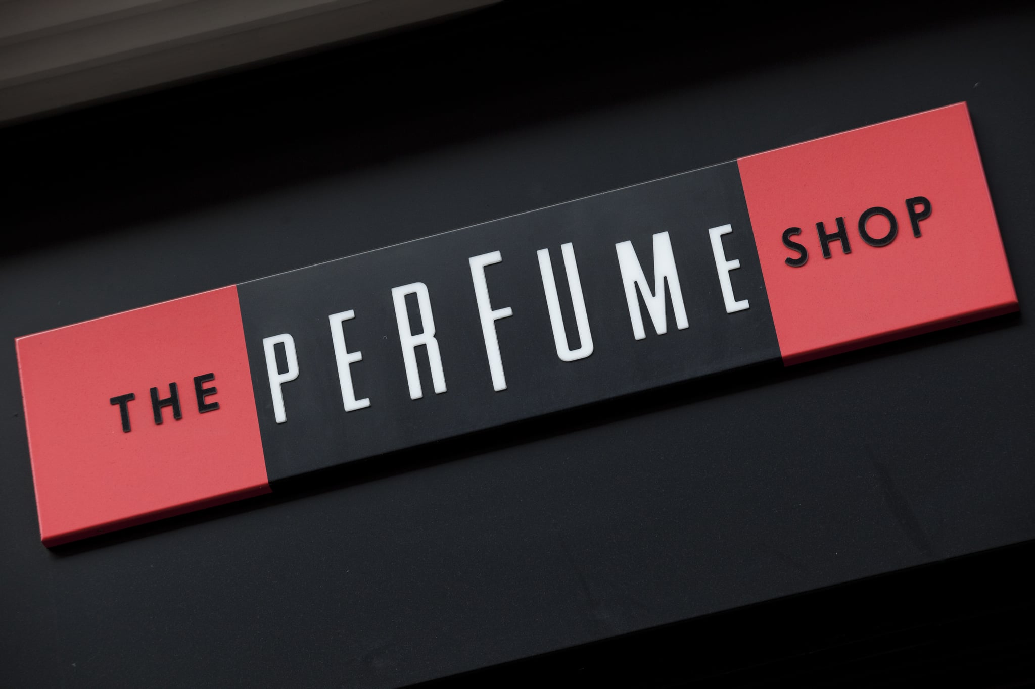 Sign for The Perfume Shop. (Photo by In Pictures Ltd./Corbis via Getty Images)