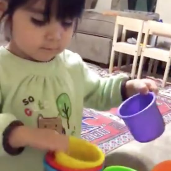 Girl Stacking Nesting Cups Video