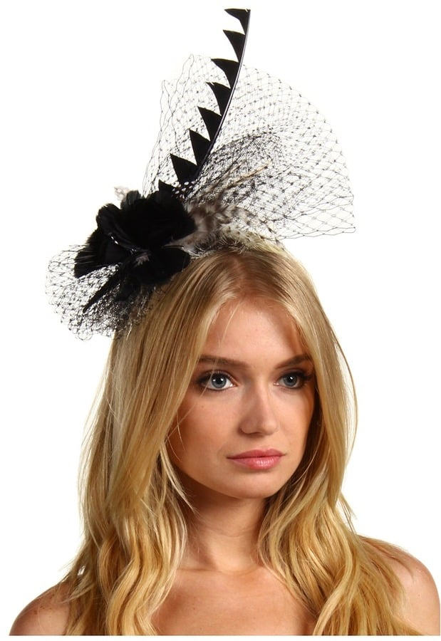 Embrace your inner royal with a full-on fascinator, like this Jane Tran Feather Net Headband ($145).