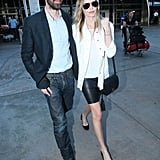 Kate Bosworth and Michael Polish walked arm in arm at Sydney Airport.