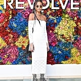 Chanel Iman wearing a crochet off-the-shoulder dress and Oliver Peoples sunglasses at the Revolve Festival party.