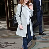 Jessica waved as she exited her Parisian hotel wearing a soft-gray coat over a white tee, skinny jeans, blue Rag & Bone ankle boots, and her black Givenchy bag.