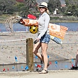 Naomi Watts brought toys to the beach.