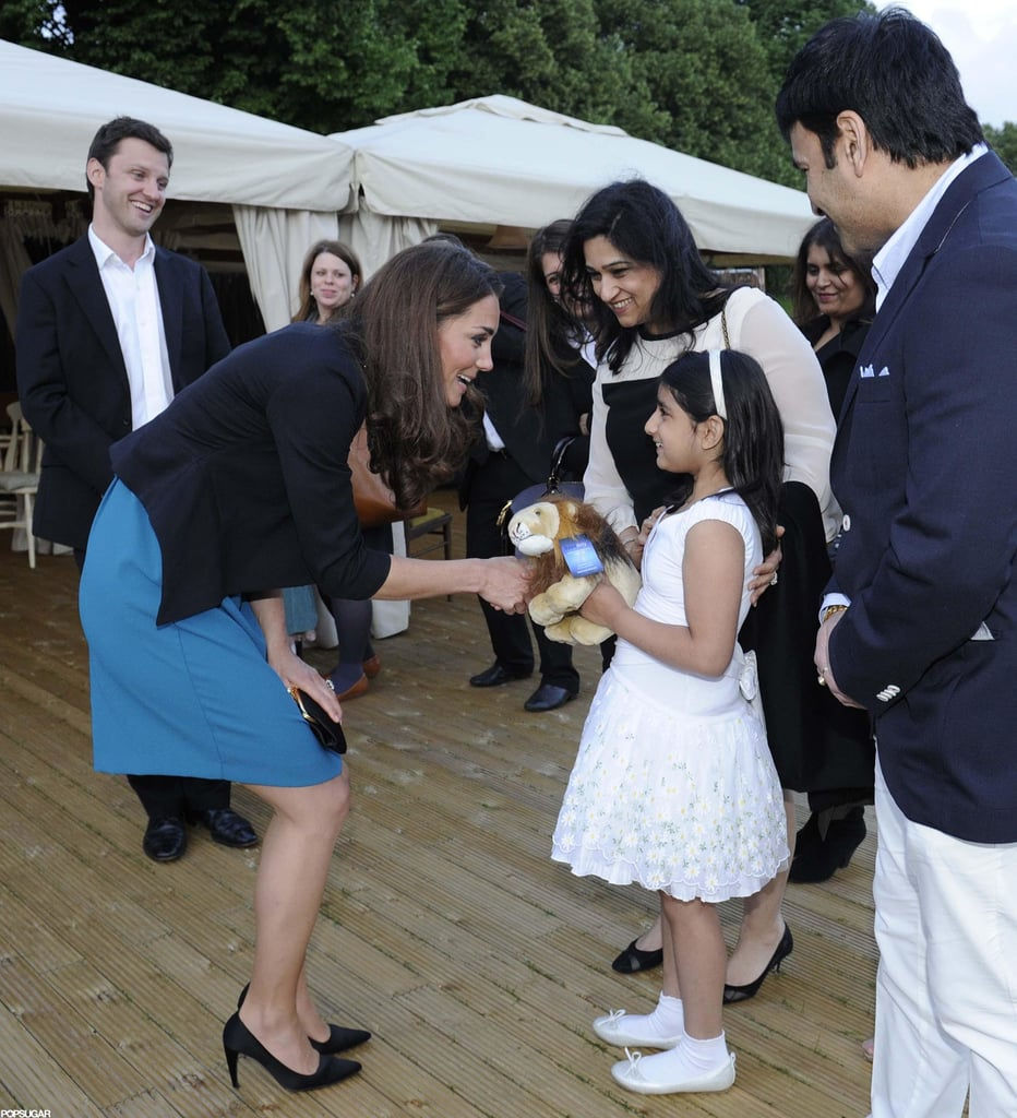 Kate Middleton played host to 150 children from The Art Room at a performance of The Lion, the Witch, and the Wardrobe in Kensington Gardens this afternoon. She wore a blue dress from Zara under a black jacket by Whistles for the occasion. Kate met with kids from various schools and actors from the play after the show. The Art Room is one of the many charities Kate is involved in as Duchess of Cambridge.  She's getting back to philanthropy after a busy string of events to celebrate the Queen's Diamond Jubilee. Kate most recently joined Prince William and the queen herself for an appearance in the East Midlands, where she played games with William and waved to the crowds from the balcony of the city's Town Hall building. Kate was able to get away from the busy Jubilee schedule for a walk with her brother, James, and dog, Lupo, last week.