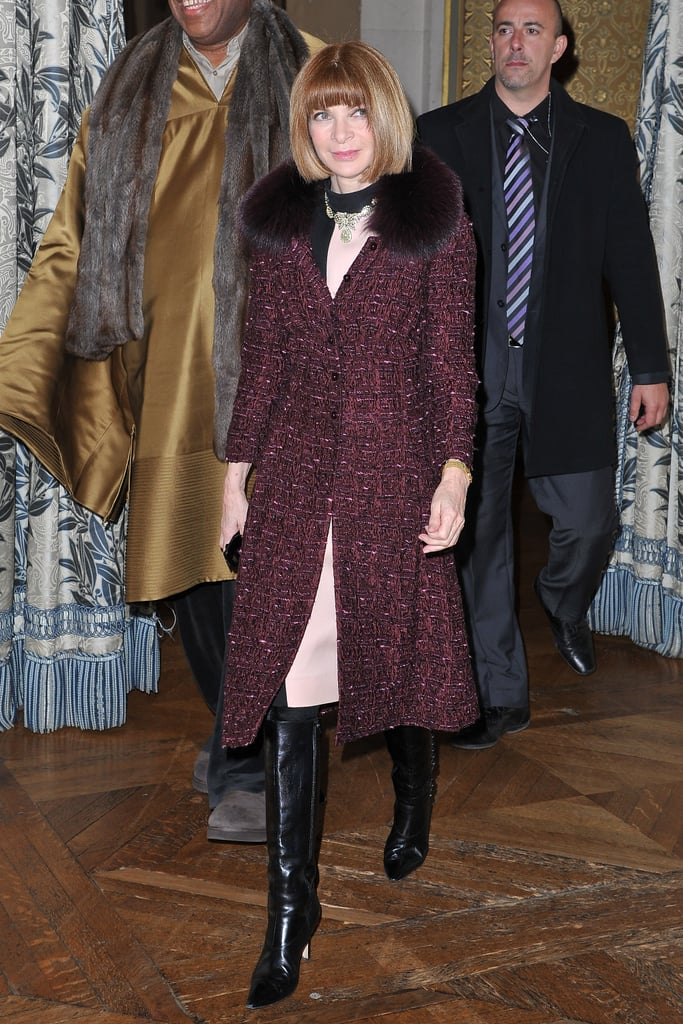 Anna Wintour wore her signature knee-high boots and elegant fur-trimmed overcoat to the Stella McCartney show.