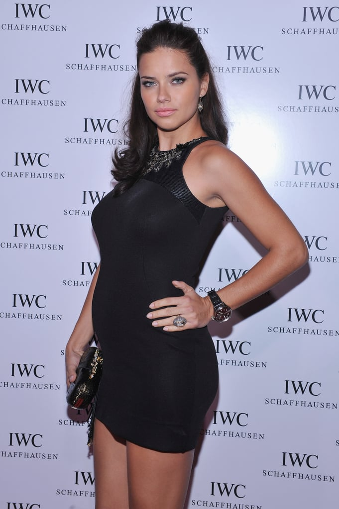 Adriana Lima wore a tight black dress.