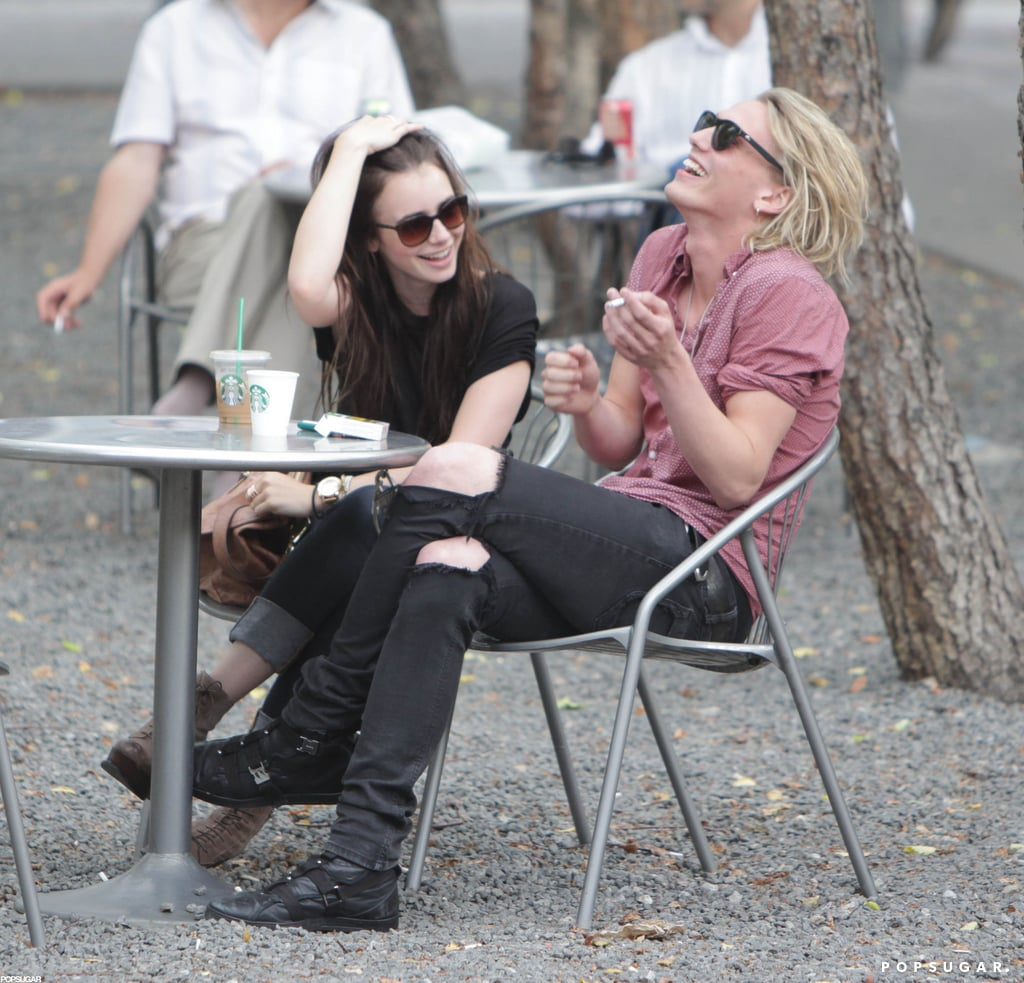Jamie Campbell Bower laughed with Lily Collins.
