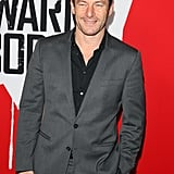 Jason Isaacs wore a gray suit and a black shirt to the premiere.